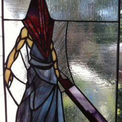 The holy unholy terror of Pyramid Head in stained glass