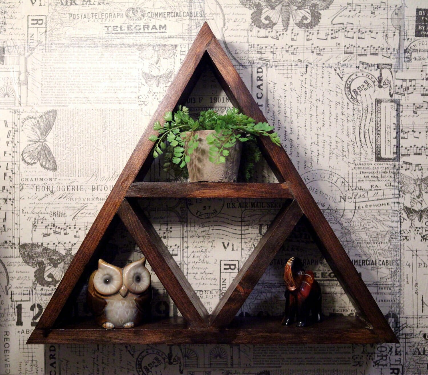 A rustic Zelda Triforce shelf