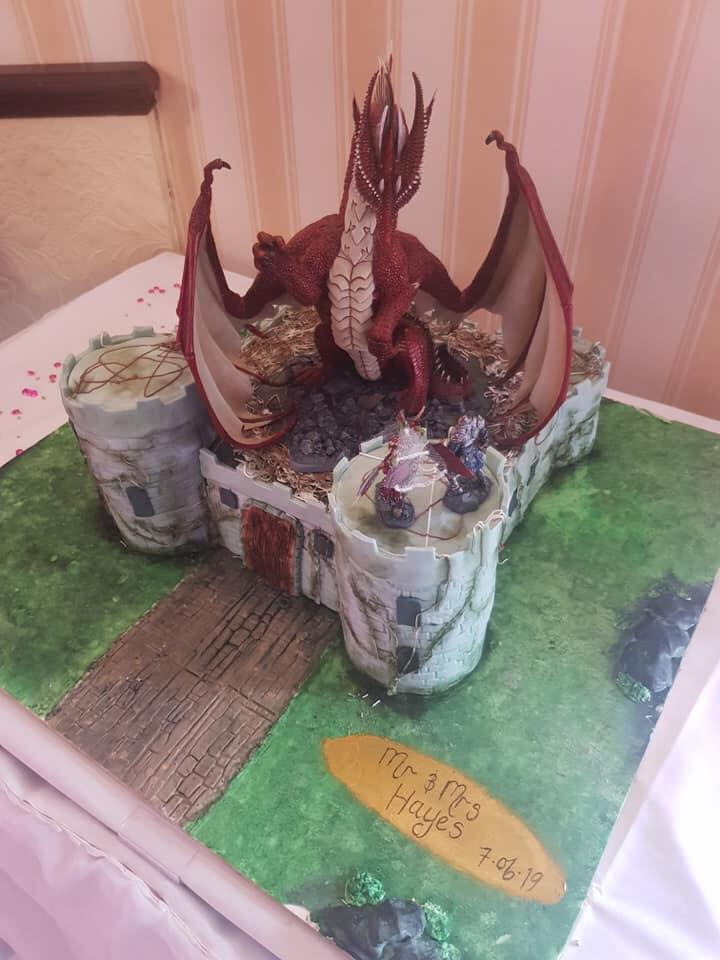 Dragon and castle wedding cake